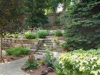 Buckhorn armourstone tiered retaining wall with steps