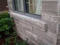 Exterior of house with custom Eramosa flamed and rockfaced window sill