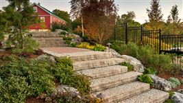 Ebel guillotined step staircase with Weathered Limestone garden rockery