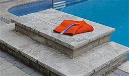 Eramosa flamed and rockfaced pool coping, stair tread and diving platform