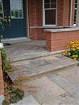 Front entrance stairs and landing built with Eramosa flamed square cut flagstone and coping