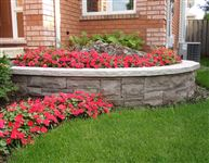 Round raised planter built with Eramosa natural bed wall stone