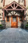 India Silver Grey square cut flagstone patio with Pennsylvania Fieldstone house exterior