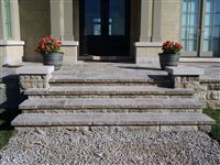 Stairs and columns with Indiana Limestone standard buff sawn edge pillar caps