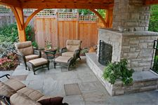 Square cut flagstone patio and outdoor fireplace built with Wiarton sawn bed building stone