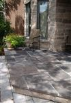 Front entrance with Ebel Black square cut flagstone and Eramosa sawn bed building stone on exterior walls
