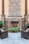 Pennsylvania Fieldstone dry-stacked fireplace with India Silver Grey square cut flagstone patio