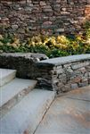 Pennsylvania Fieldstone dry-stacked garden and seat wall with New York bluestone random flagstone, steps and coping