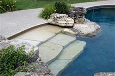 Weathered Limestone boulders and random garden steps into pool