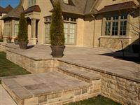 Stairs and raised patio built with Ebel natural bed building stone