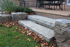 Ebel guillotined steps up to deck with Flamboro Dark armourstone garden wall