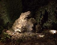 Weathered Limestone drilled rock water feature at night