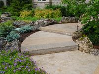Curved walkway with Wiarton guillotined steps and oversized random flagstone