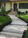 Wiarton guillotined steps and square cut flagstone walkway to front entrance