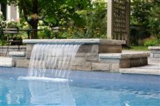 Diving platform and cascading water feature built with Wiarton sawn bed building stone