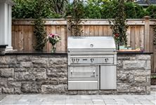 Outdoor kitchen built with Owen Sound Brown sawn bed building stone