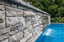 Freestanding garden wall and cascading water feature built with Owen Sound Brown sawn bed building stone