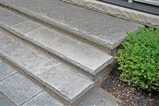 Eramosa flamed and rockfaced coping used as stair treads