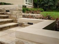 Custom Indiana Limestone standard buff sawn coping on freestanding garden wall