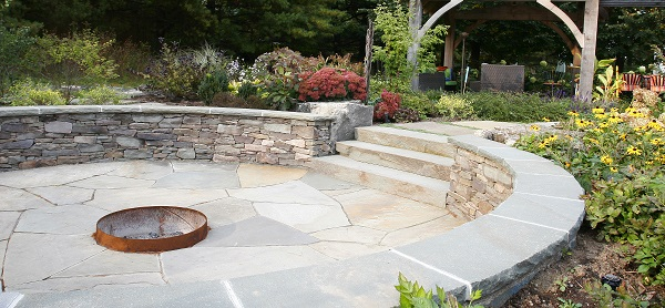 outdoor firepit in a sunken random flagstone patio