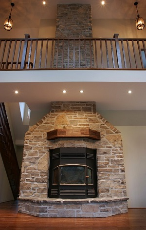 interior, multi-storey stone fireplace