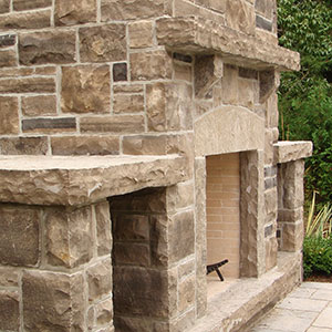 custom natural stone outdoor fireplace detail