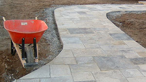 square cut flagstone walkway under construction