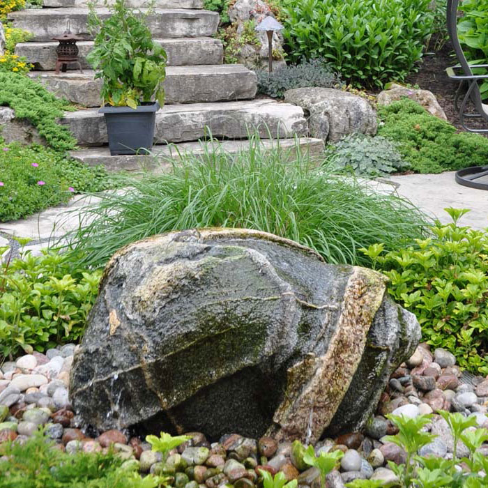 drilled granite boulder bubbling rock water feature