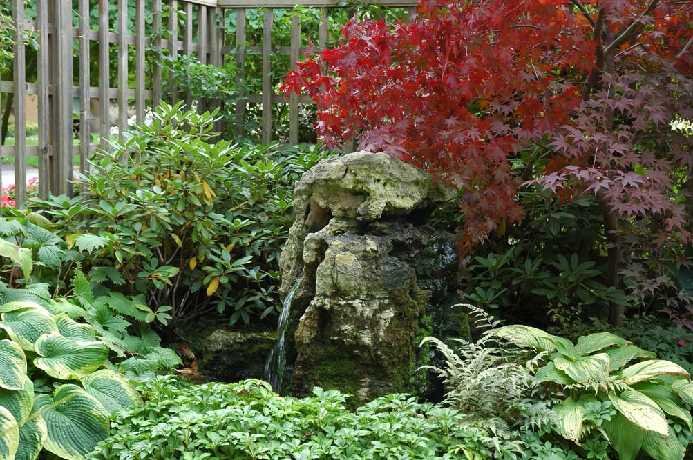 ... Mossy Weathered Limestone Drilled Rock Water Feature In Flower Bed ...